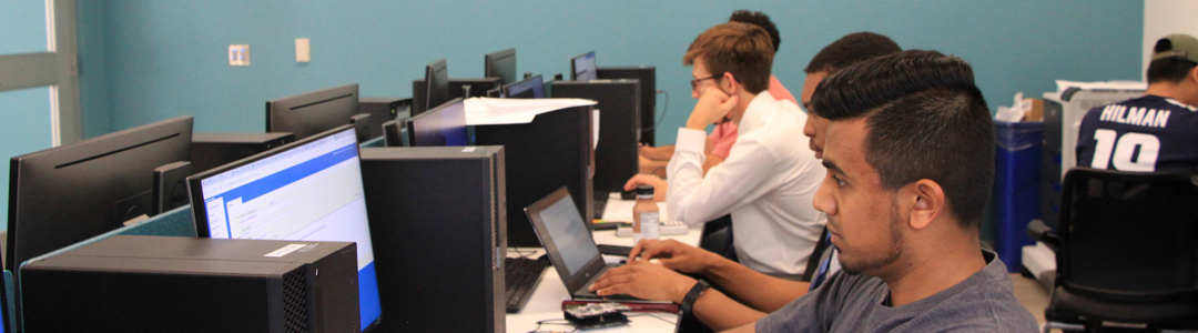 Students in a computer lab within E-Knowledge Commons
