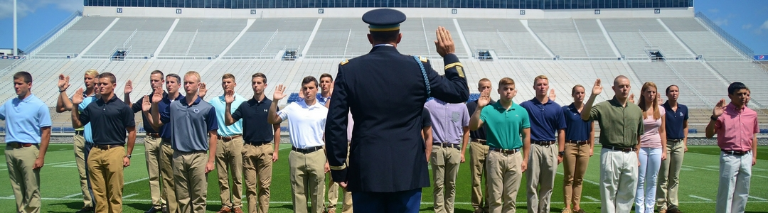 Students in formation taking pledge from military officer