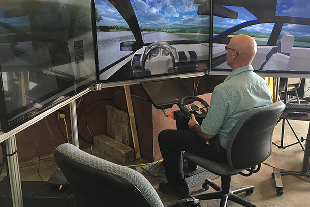 Denny Kovalick, test track manager for The Larson Transportation Institute, takes the highway driving simulator for a test drive before the 2017 Pennsylvania Automated Vehicle Summit.