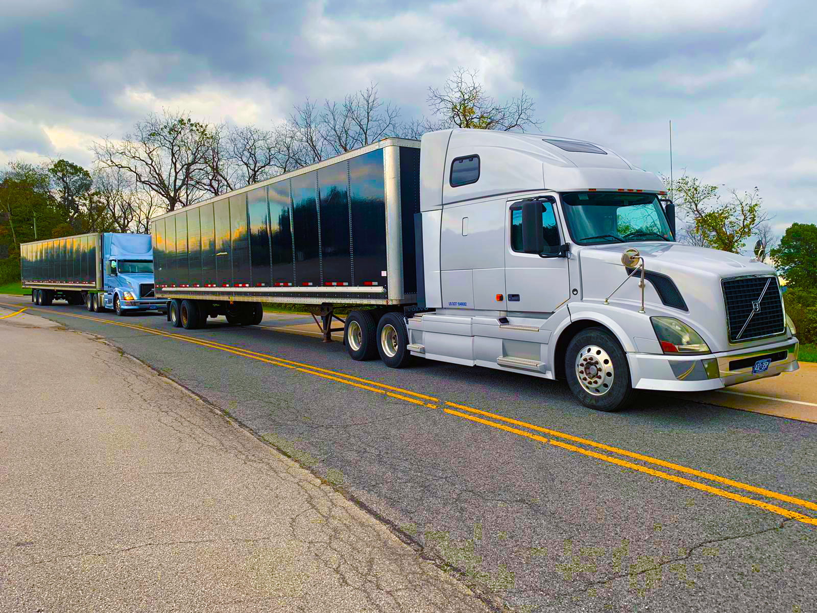 Truck platoons, or groups of vehicles traveling together on a roadway in a flock, have the potential to increase both road capacity and fuel efficiency. The adoption of autonomous driving technology could boost these benefits even more.